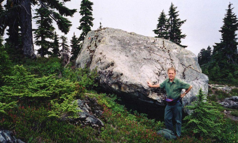 Glacial erratic of granite lying on metavolcanics, Mt Strachan