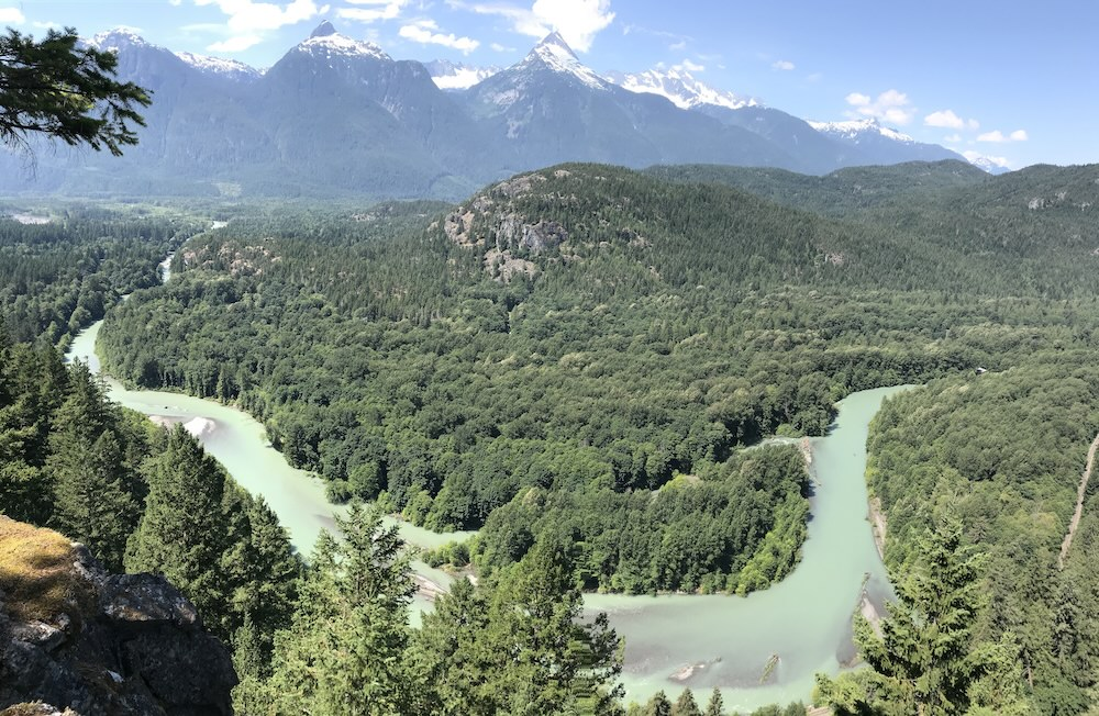 Bend in Cheakamus River from Cheakamus Viewpoint, with Tantalus Range in background.